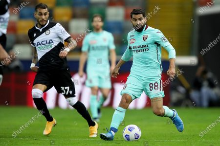 Udinese's Roberto Pereyra (L) and Torino's Tomas Rincon in action during the Italian Serie A soccer match Udinese Calcio vs Torino FC at the Friuli - Dacia Arena stadium in Udine, Italy, 10 April 2021.