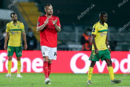 Benfica's Haris Seferovic (C) celebrates after scoring a goal against Pacos de Ferreira during their Portuguese First League soccer match held in Pacos de Ferreira, Portugal, 10 April 2021.