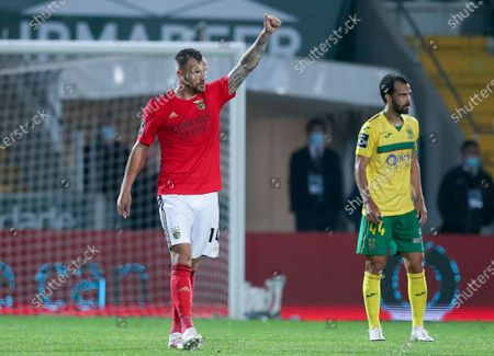 Benfica's Haris Seferovic (L) celebrates after scoring a goal against Pacos de Ferreira during their Portuguese First League soccer match held in Pacos de Ferreira, Portugal, 10 April 2021.