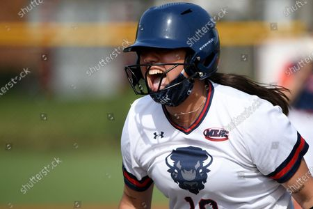 Stock Picture of Howard batter Natalie Davila (10) celebrates after hitting a two-run walk-off single to beat Morgan St. during an NCAA softball game, in Washington