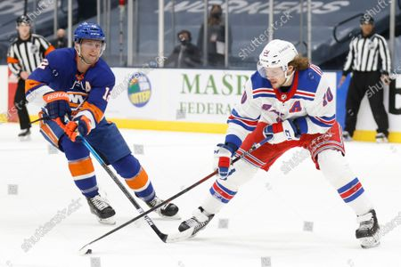 New York Rangers' Artemi Panarin (10), of Russia, controls the puck against New York Islanders' Josh Bailey (12) during the first period of an NHL hockey game, in Uniondale, N.Y. The Rangers won 4-1