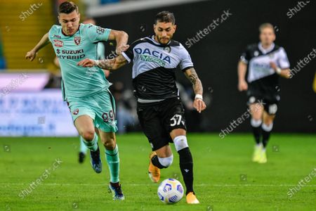 Alessandro Buongiorno (Torino FC) and Roberto Pereyra (Udinese Calcio) in action