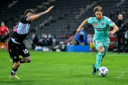 Cristian Ansaldi (Torino FC) in action and Rodrigo de Paul (Udinese Calcio)