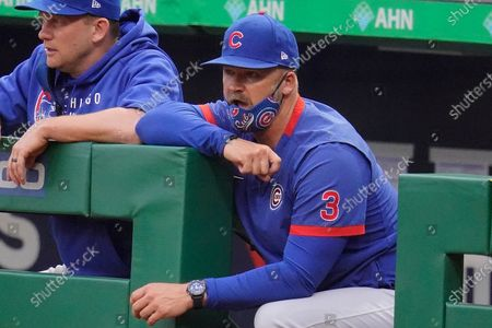 Chicago Cubs manager David Ross stands in the dugout during a baseball game against the Pittsburgh Pirates in Pittsburgh