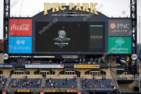 Fans attending a baseball game between the Pittsburgh Pirates and the Chicago Cubs at PNC Park pause for a moment of silence in honor of Pittsburgh Pirates usher Phil Coyne, who tended seats for Pirates fans for 81 years, in Pittsburgh on . Coyne passed away this week at the age of 102