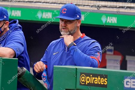 Chicago Cubs manager David Ross stands in the dugout during the team's baseball game against the Pittsburgh Pirates in Pittsburgh