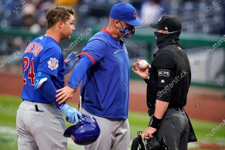 Chicago Cubs' Joc Pederson, left, disagrees with a third-strike call by umpire Will Little, right, as manager David Ross steps between them during the first inning of the team's baseball game against the Pittsburgh Pirates in Pittsburgh