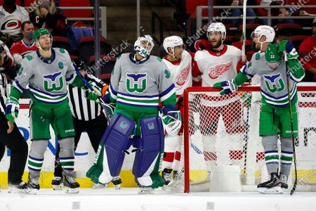 Stock Image of Carolina Hurricanes goaltender Petr Mrazek (34), Jordan Staal (11) and Brett Pesce (22) react following a goal by Detroit Red Wings' Valtteri Filppula (51) with Red Wings' Michael Rasmussen (27) and Dylan Larkin (71) nearby during the second period of an NHL hockey game in Raleigh, N.C