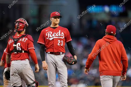 Cincinnati Reds manager David Bell, right, arrives on the mound to remove starting pitcher Jeff Hoffman (23) from the baseball game as Reds catcher Tucker Barnhart stands near the mound during the fifth inning against the Arizona Diamondbacks, in Phoenix