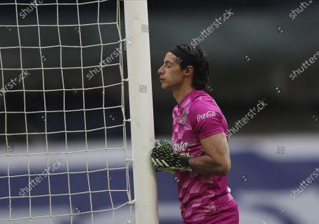 Guadalajara goalkeeper Jose Rodriguez prays before a Mexican soccer league match against Cruz Azul in Mexico City