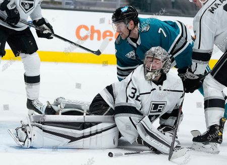 San Jose Sharks center Dylan Gambrell (7) watches his goal against Los Angeles Kings goaltender Jonathan Quick (32) during the first period of an NHL hockey game, in San Jose, Calif