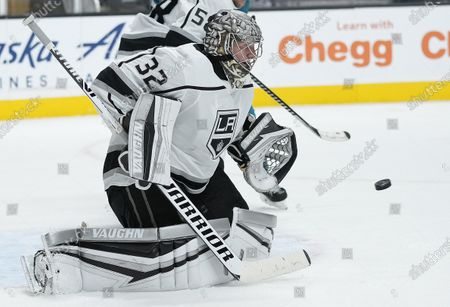 Los Angeles Kings goaltender Jonathan Quick blocks a shot by the San Jose Sharks during the third period of an NHL hockey game, in San Jose, Calif. Los Angeles won 4-2
