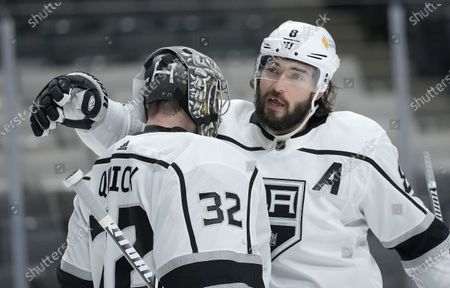 Los Angeles Kings defenseman Drew Doughty (8) hugs goaltender Jonathan Quick (32) after the team's 4-2 victory over the San Jose Sharks in an NHL hockey game, in San Jose, Calif