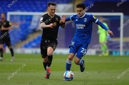 Stock Picture of Ipswichs Andre Dozzell and MK Dons Josh Mceachran come together during the Sky Bet League 1 match between Ipswich Town and MK Dons at Portman Road, Ipswich, England on 10th April 2021.
