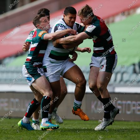Joel Matavesi of Newcastle Falcons is held by George Ford of Leicester Tigers and Harry Potter of Leicester Tigers during the European Rugby Challenge Cup Quarter Final match between Leicester Tigers and Newcastle Falcons at Welford Road, Leicester, England on 10th April 2021.