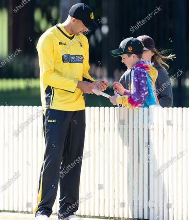 Ashton Agar of Western Australia signs autographs during the 2021 Marsh One Day Cup Final match between New South Wales and Western Australia.
