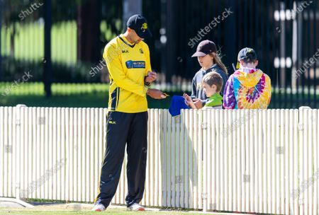 Stock Picture of Ashton Agar of Western Australia signs autographs during the 2021 Marsh One Day Cup Final match between New South Wales and Western Australia.