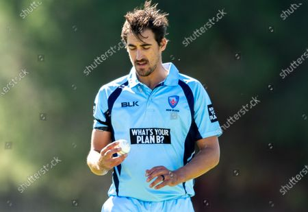 Stock Photo of Mitchell Starc of NSW looks on during the 2021 Marsh One Day Cup Final match between New South Wales and Western Australia at Bankstown Oval.