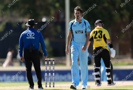 Mitchell Starc of NSW walks back to his run-up during the 2021 Marsh One Day Cup Final match between New South Wales and Western Australia at Bankstown Oval.