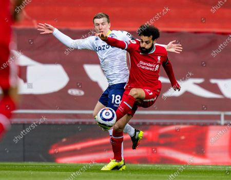 """(210411) - LIVERPOOL, April 11, 2021 (Xinhua) - Liverpool's Mohamed Salah (R) competes with Aston Villa's Matt Targett during the Premier League match between Liverpool FC and Aston Villa FC at Anfield in Liverpool, Britain, on April 10, 2021. (Xinhua) FOR EDITORIAL USE ONLY. NOT FOR SALE FOR MARKETING OR ADVERTISING CAMPAIGNS. NO USE WITH UNAUTHORIZED AUDIO, VIDEO, DATA, FIXTURE LISTS, CLUB/LEAGUE LOGOS OR """"LIVE"""" SERVICES. ONLINE IN-MATCH USE LIMITED TO 45 IMAGES, NO VIDEO EMULATION. SUN OUT. NO USE IN BETTING, GAMES OR SINGLE CLUB/LEAGUE/PLAYER PUBLICATIONS. - Xinhua -"""