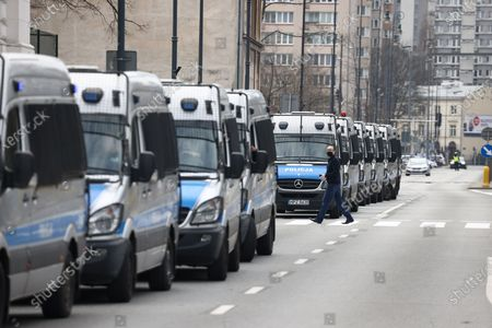Police are seen sealing off streets leading to Pilsudski Square where president Andrzej Duda is to attend the 11th anniversary of the Smolensk air disaster in Warsaw, Poland on April 10, 2021. President Duda commemorated the 97 casualties of the Smolensk government plance crash from April 10, 2010 in which then president Lech Kaczynski also died. The ceremony on Saturday was cut off for all but state media and the vicinity of the ceremony had been hermetically sealed by police to ward off potential protesters. An investigation led by former minister of defence Antoni Macierewicz is said to conclude the 2010 Smolensk air crash was the result of an explosion despite official investigations having concluded the result of the crash came from human error leading to collision with a tree while flying a low altitude in low visibility circumstances.