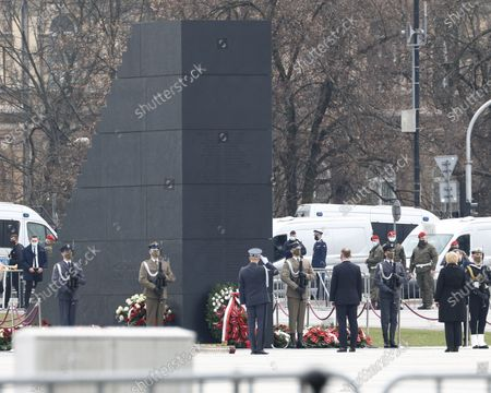 President Andrzej Duda is seen taking part in the ceremony commemorating the 2010 Smolensk air disaster in Warsaw, Poland on April 10, 2021. President Duda commemorated the 97 casualties of the Smolensk government plance crash from April 10, 2010 in which then president Lech Kaczynski also died. The ceremony on Saturday was cut off for all but state media and the vicinity of the ceremony had been hermetically sealed by police to ward off potential protesters. An investigation led by former minister of defence Antoni Macierewicz is said to conclude the 2010 Smolensk air crash was the result of an explosion despite official investigations having concluded the result of the crash came from human error leading to collision with a tree while flying a low altitude in low visibility circumstances.