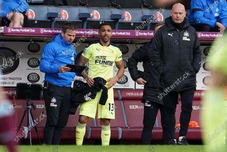Stock Photo of Newcastle's Callum Wilson prepares to come onto the pitch as a replacement during the English Premier League soccer match between Burnley and Newcastle United at Turf Moor in Burnley, England