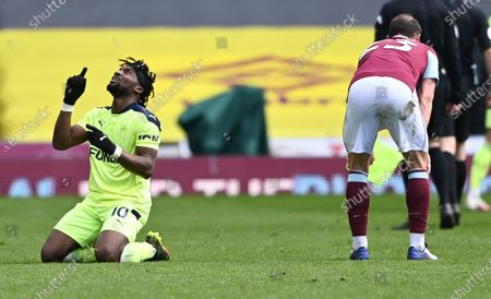 Newcastle's Allan Saint-Maximin, left, reacts following the English Premier League soccer match between Burnley and Newcastle United at Turf Moor in Burnley, England