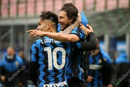 Matteo Darmian (R) of FC Internazionale celebrates with Lautaro Martinez (L) after scoring the his team's first goal during the Serie A match between FC Internazionale  and Cagliari Calcio at Stadio Giuseppe Meazza on April 11, 2021 in Milan, Italy. Sporting stadiums around Italy remain under strict restrictions due to the Coronavirus Pandemic as Government social distancing laws prohibit fans inside venues resulting in games being played behind closed doors.
