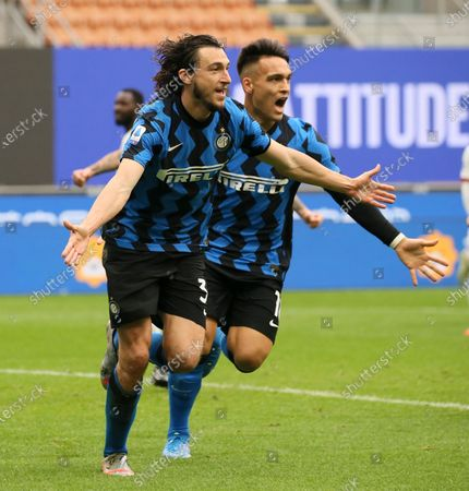 Matteo Darmian (L) of FC Internazionale celebrates with Lautaro Martinez (R) after scoring the his team's first goal during the Serie A match between FC Internazionale  and Cagliari Calcio at Stadio Giuseppe Meazza on April 11, 2021 in Milan, Italy. Sporting stadiums around Italy remain under strict restrictions due to the Coronavirus Pandemic as Government social distancing laws prohibit fans inside venues resulting in games being played behind closed doors.