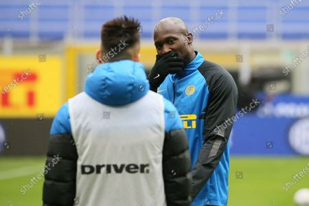Lautaro Martinez of FC Internazionale (L) talk with Romelu Lukaku (R) before the Serie A match between FC Internazionale  and Cagliari Calcio at Stadio Giuseppe Meazza on April 11, 2021 in Milan, Italy. Sporting stadiums around Italy remain under strict restrictions due to the Coronavirus Pandemic as Government social distancing laws prohibit fans inside venues resulting in games being played behind closed doors.