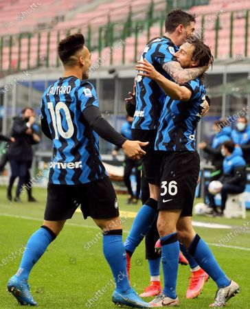 Matteo Darmian of FC Internazionale celebrates with Lautaro Martinez and Alessandro Bastoni after scoring the opening goal during the Serie A match between FC Internazionale  and Cagliari Calcio at Stadio Giuseppe Meazza on April 11, 2021 in Milan, Italy. Sporting stadiums around Italy remain under strict restrictions due to the Coronavirus Pandemic as Government social distancing laws prohibit fans inside venues resulting in games being played behind closed doors.