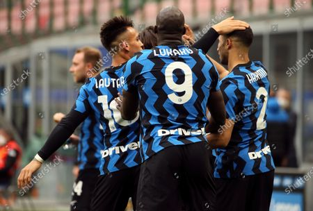 Lautaro Martinez (L) of FC Internazionale celebrates with Romelu Lukaku (C) and Achraf Hakimi (L) during the Serie A match between FC Internazionale  and Cagliari Calcio at Stadio Giuseppe Meazza on April 11, 2021 in Milan, Italy. Sporting stadiums around Italy remain under strict restrictions due to the Coronavirus Pandemic as Government social distancing laws prohibit fans inside venues resulting in games being played behind closed doors.