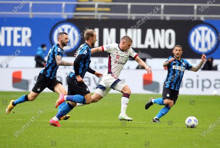 Cagliari's Razvan Marin (C) challenges for the ball with Inter Milan's Christian Eriksen during the Italian serie A soccer match between FC Inter and Cagliari Calcio at Giuseppe Meazza stadium in Milan, Italy, 11 April 2021.