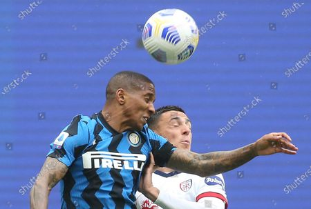 Stock Photo of Inter Milan's Ashley Young (L) challenges for the ball with Cagliari's Gabriele Zappa during the Italian serie A soccer match between FC Inter and Cagliari Calcio at Giuseppe Meazza stadium in Milan, Italy, 11 April 2021.