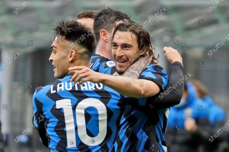 Inter Milan's Matteo Darmian, right, celebrates with teammate Inter Milan's Lautaro Martinez, left, after scoring during a Serie A soccer match between Inter Milan and Cagliari at the San Siro stadium in Milan, Italy