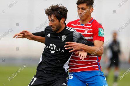 Esteban Granero of Marbella FC and Raul Torrente of Recreativo Granada during the Second Division B match between Recreativo Granada and Marbella FC at Ciudad Deportiva Granada CF on April 11, 2021 in Granada, Spain.