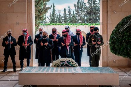 This photo from the Royal Court twitter account, shows Jordan's King Abdullah II, center, Prince Hamzah bin Al Hussein, second left, and others during a visit to the tomb of the late King Hussein. Abdullah II and his half brother Prince Hamzah have made their first joint public appearance since a palace feud last week. Members of the Jordanian royal family Sunday marked the centenary of the establishment of the Emirate of Transjordan, a British protectorate that preceded the kingdom