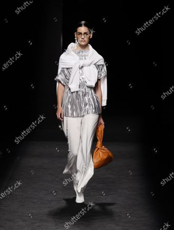 A model presents a creation from the Fall-Winter 2021/2022 collection of Corsicana fashion brand as part of the young talents of Ego show during a show at the 73rd Mercedes-Benz Fashion Week Madrid, in Madrid, Spain, 11 April 2021. The fashion event runs from 08 to 11 April.
