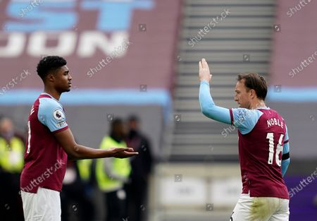 West Ham United's Ben Johnson, left, comes on as a substitute to replace Mark Noble during the English Premier League soccer match between West Ham United and Leicester City at the London Stadium in London
