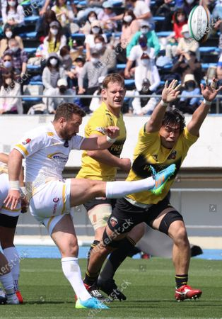 Stock Image of NTT Communications Shining Arcs scrum half Greig Laidlaw kicks the ball at a match of Japan Rugby Top League 2021 tournament at the Komazawa Olympic Park stadium in Tokyo on Sunday, April 11, 2021. Suntory Sungoliath defeated Ntt Communications Shining Arcs  94-31.