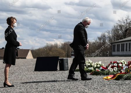German President Frank-Walter Steinmeier (R) and his wife Elke Buedenbender lays down a wreath during a commemorative event marking the 76th anniversary of the liberation of Buchenwald and Mittelbau-Dora concentration camps, on its former roll call ground in Weimar, Germany, 11 April 2021. Buchenwald, liberated by US troops on 11 April 1945, was the biggest concentration camp on German soil. More than 250,000 people were imprisoned there over a period of eight years. Some 56,000 are believed to have died there, either murdered or having succumbed to disease and starvation.