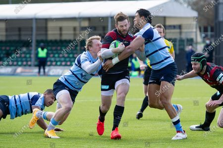 Elliot Daly of Saracens takes on the Bedford Blues defence