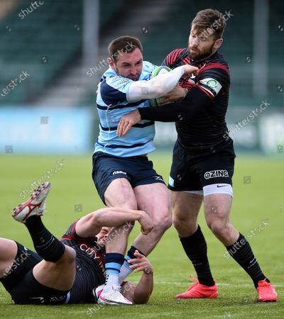 Rich Lane of Bedford Blues is tackled by Elliot Daly of Saracens