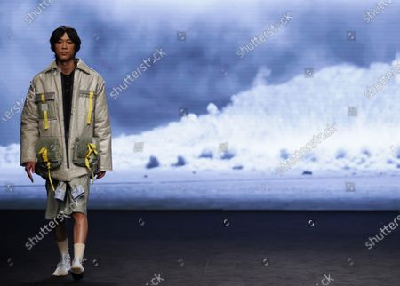 A model presents a creation from the Fall-Winter 2021/2022 collection of Rubearth fashion brand as part of the young talents of Ego show during a show at the 73rd Mercedes-Benz Fashion Week Madrid, in Madrid, Spain, 11 April 2021. The fashion event runs from 08 to 11 April.