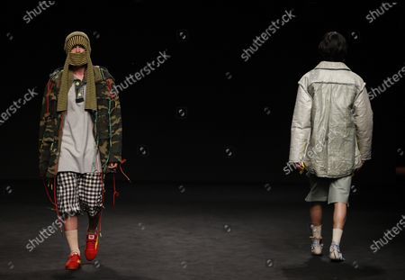 Models present creations from the Fall-Winter 2021/2022 collection of Rubearth fashion brand as part of the young talents of Ego show during a show at the 73rd Mercedes-Benz Fashion Week Madrid, in Madrid, Spain, 11 April 2021. The fashion event runs from 08 to 11 April.