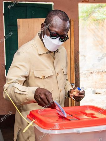 Benin's President Patrice Talon casts his ballot in the Benin presidential elections in Cotonou, Benin 11 April 2021. Benin's President Patrice Talon a cotton businessman elected in 2016 is the favorite to win a second term in office in Benin one of the worlds smallest and poorest countries.
