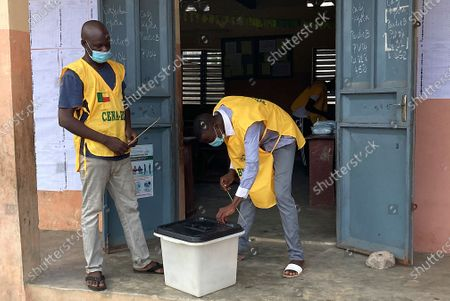 Electoral officials secure a ballot box during the Benin presidential elections in Cotonou, Benin 11 April 2021. Benin's President Patrice Talon a cotton businessman elected in 2016 is the favorite to win a second term in office in Benin one of the worlds smallest and poorest countries.