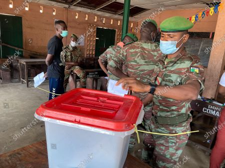 Stock Image of A soldier from Benin casts his ballot during the Benin presidential elections in Cotonou, Benin 11 April 2021. Benin's President Patrice Talon a cotton businessman elected in 2016 is the favorite to win a second term in office in Benin one of the worlds smallest and poorest countries.