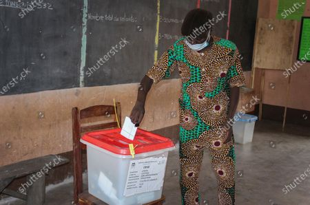 A man casts his ballot in the Benin presidential elections in Cotonou, Benin, 11 April 2021. Benin's President Patrice Talon, a cotton businessman elected in 2016, is the favorite to win a second term in office in Benin, one of the worlds smallest and poorest countries.